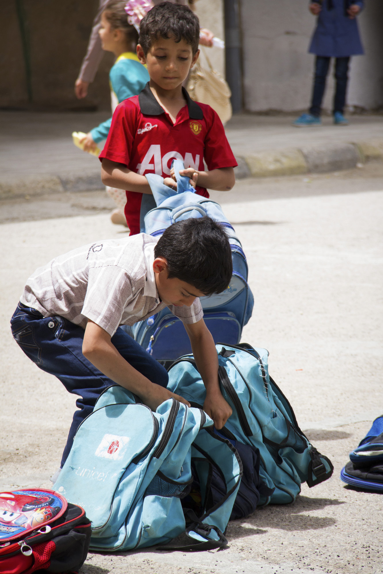 Most of the Syrian refugee students have a UNICEF school bag. They depend on the help of international organizations to participate in school life.