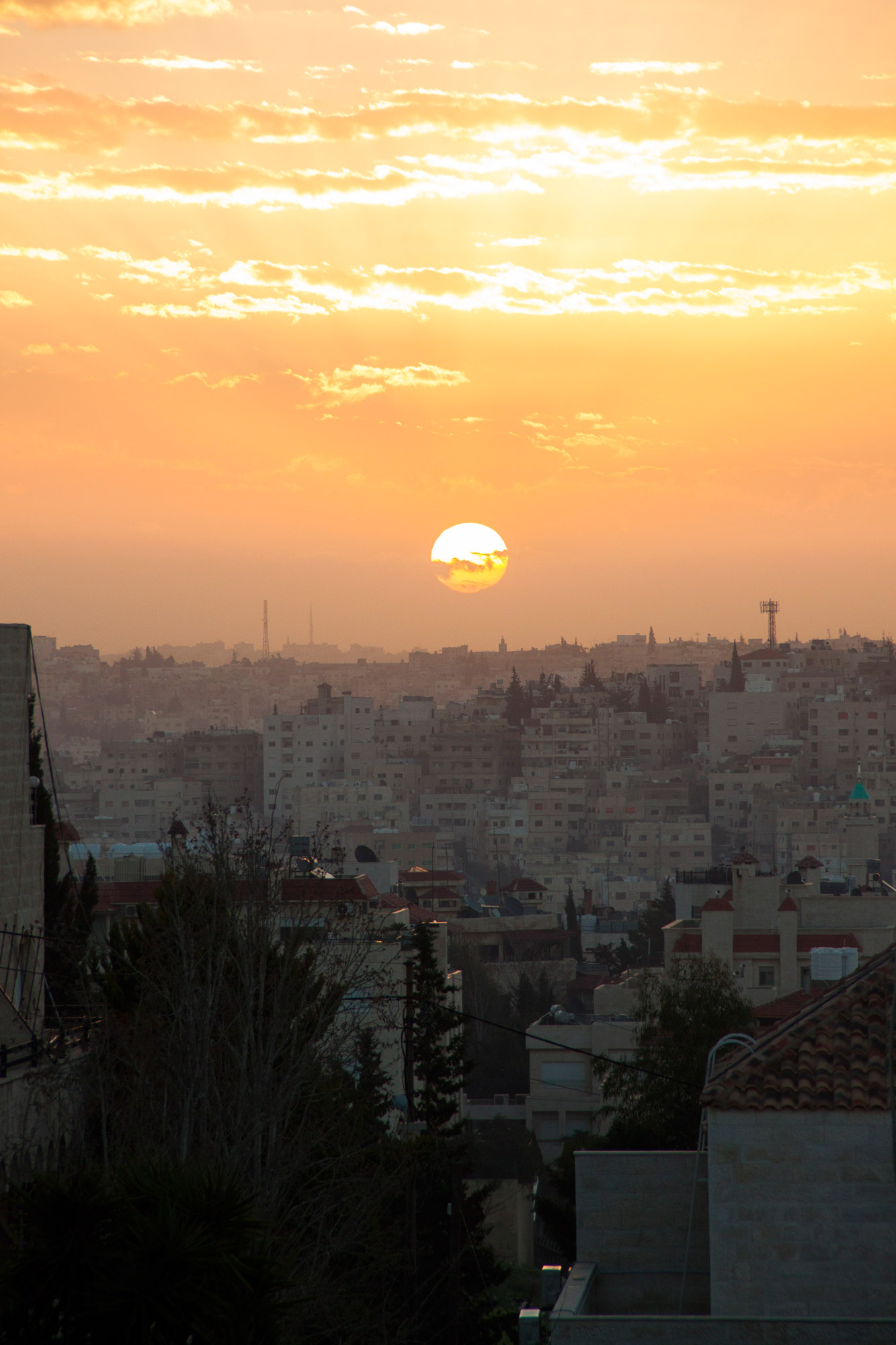 The sunsets and sunrises in Amman are breathtaking. The white buildings are glided by the red sun and the birds are chirping.